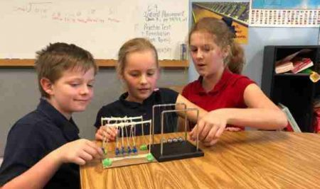 5th Graders Challenged to Make their Own Newton's Cradle