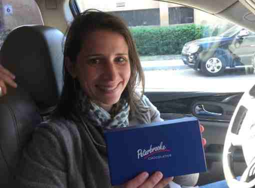 Private christian school parent holding Peterbrooke chocolate gift certificate