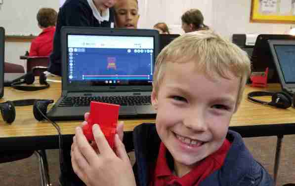 2nd grader with 3D model, private christian school