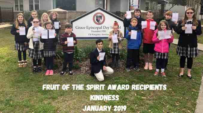 Private christian school fruit of the spirit award recipients standing in front of school sign