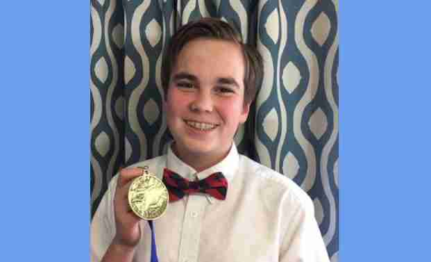 Middle school boy with Geography Bee medal