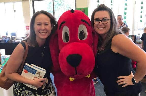 two parent volunteers with Clifford the Big Red Dog