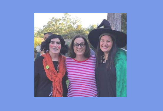 Three female adminstrators dressed in costumes