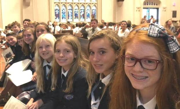 Four smiling girls at Chapel