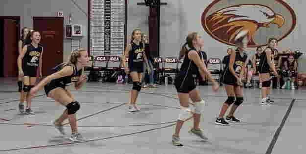 Action shot of girls volleyball team