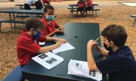 5th Graders Enjoy Working Together Outside on New Picnic Tables