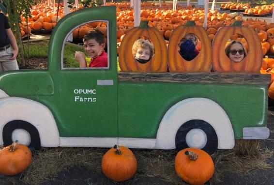 children posing with pumpkins