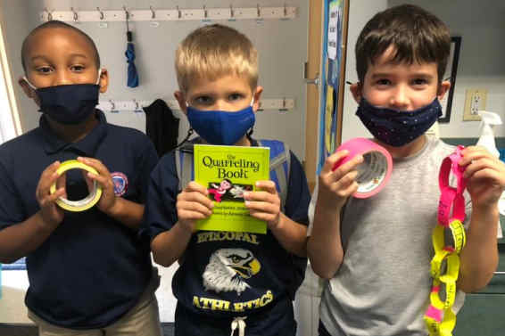 Three 2nd grade boys showing off their Kindness activity