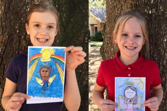 Two students displaying Angels of Allison card creations