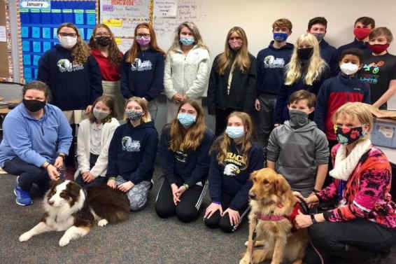 Group of students, volunteers from Humane Society and two dogs