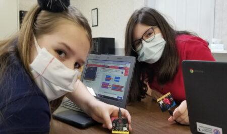 Fifth Graders Code Handheld Computers