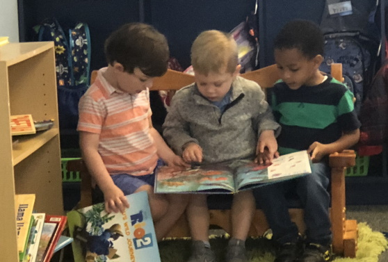 Three preschool boys reading together for March Madness Reading Challenge